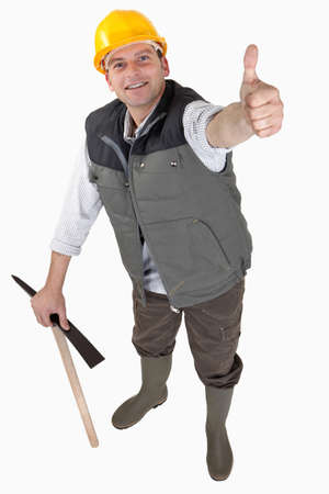 Delighted laborer with thumb up Stock Photo - 17579577