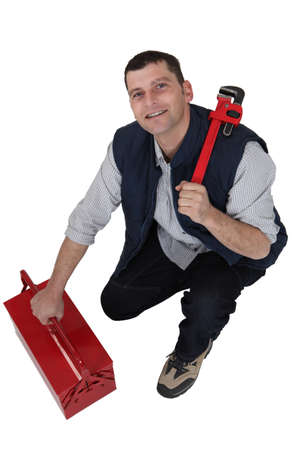 odd jobs: Tradesman with a pipe wrench and toolbox