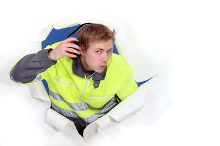 decibels: Man wearing reflective jacket and hearing protection