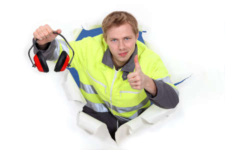 defenders: Worker giving the thumbs up to ear defenders