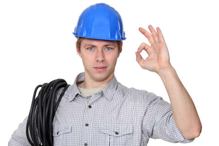 Electrician giving the ok sign photo