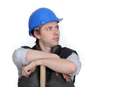 pawn adult: Worker resting on wooden stick Stock Photo