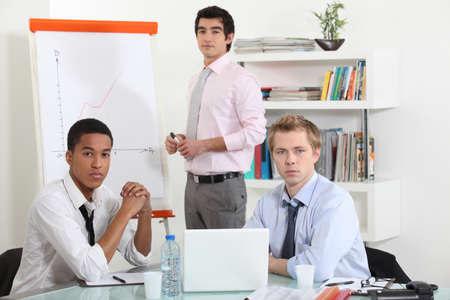 workshop seminar: young businessmen on a meeting Stock Photo