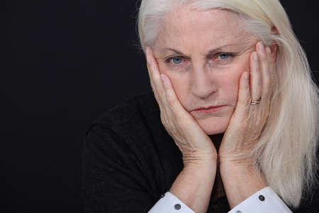 Old woman coping with loss photo