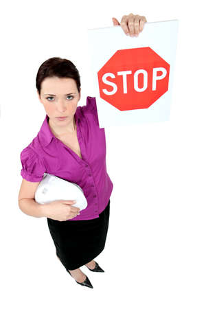 disclaim: Architect holding stop sign