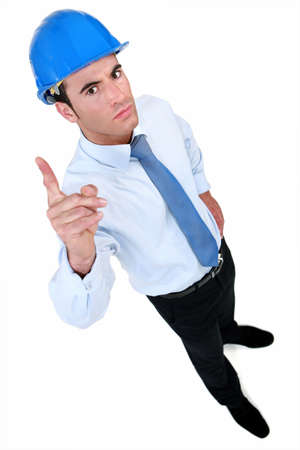 pointed arm: Angry man seen from above Stock Photo