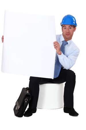 incertitude: Engineer holding a blank sign