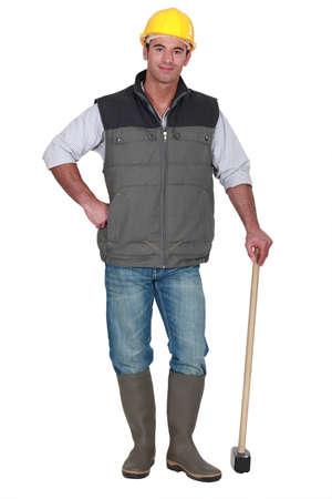 sledgehammer: Construction worker posing with sledge-hammer Stock Photo