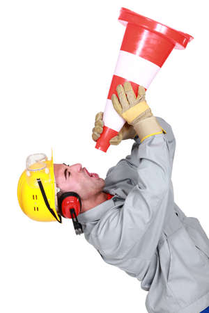 Angry tradesman yelling into a megaphone photo