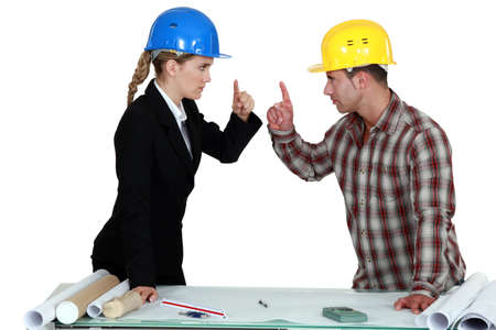 Engineer having an argument with a tradesman Stock Photo - 17578572