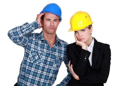 jaded: Annoyed construction worlers Stock Photo