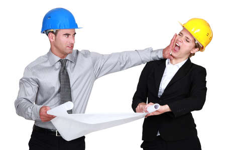 grudging: Engineer jealous of his  colleague Stock Photo