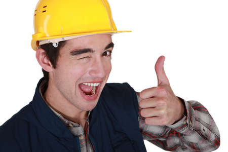Tradesman winking and giving the thumbs up photo