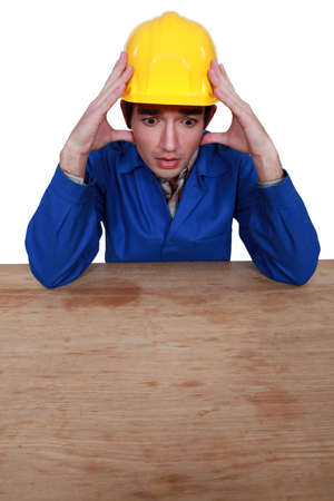 Stressed construction worker photo