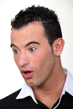 strangeness: Portrait of a surprised man