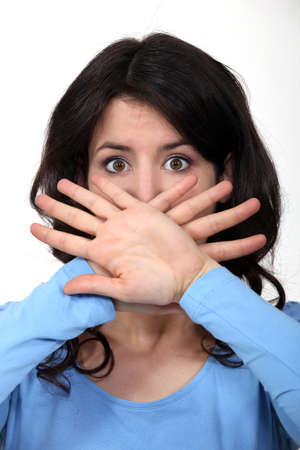 Woman hiding her mouth photo
