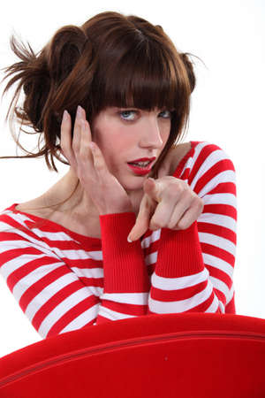 Fashionable woman pointing her finger Stock Photo - 17584526
