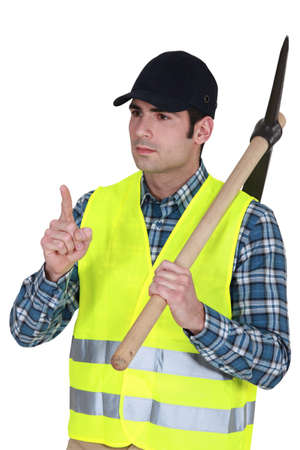 Labourer carrying a pickaxe Stock Photo - 17732530
