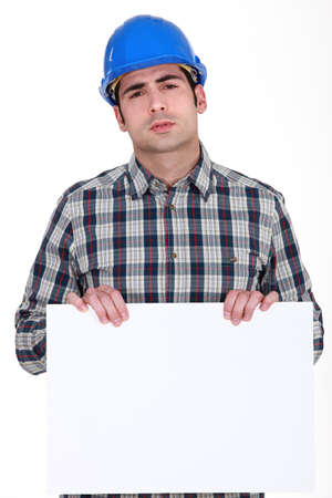 protective workwear: Builder holding poster Stock Photo