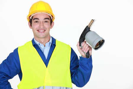 Young worker with blow torch photo