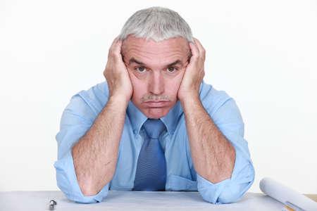 afflict: mature businessman visibly bored