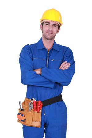 journeyman technician: Worker wearing a toolbelt