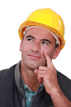 Builder thinking of an idea Stock Photo - 17732475