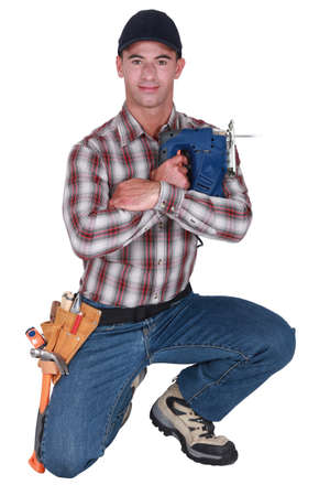 A handyman with a jigsaw Stock Photo - 17732551