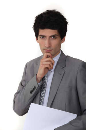 Pensive businessman holding paperwork Stock Photo - 17732585