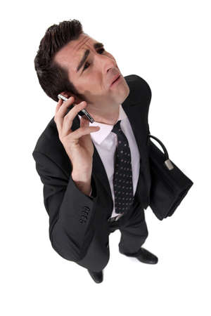 annoyance: Businessman being nagged by his wife