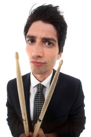 distorted image: distorted image of man in suit with drumsticks Stock Photo
