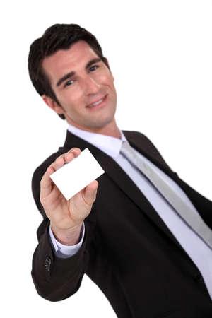 Businessman presenting his card Stock Photo - 17716172