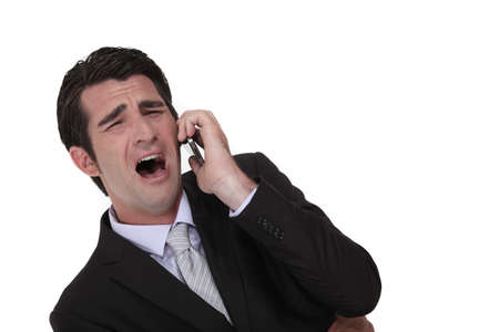 Businessman screaming down the phone Stock Photo - 17732294