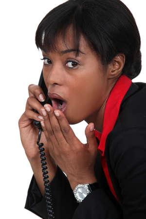 sensational: black businesswoman on the phone  shocked at sensational news