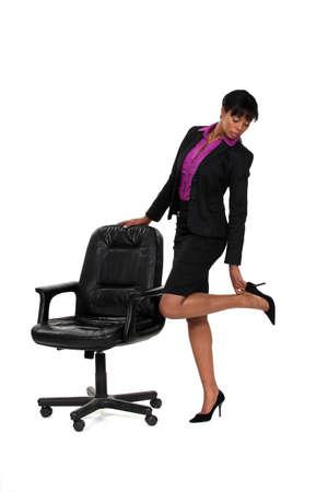 Businesswoman checking her heels photo