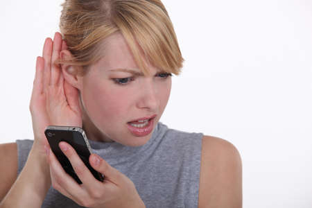 nice looking: A nice looking woman having troubles hearing  Stock Photo