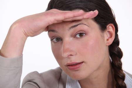 Businesswoman saluting photo