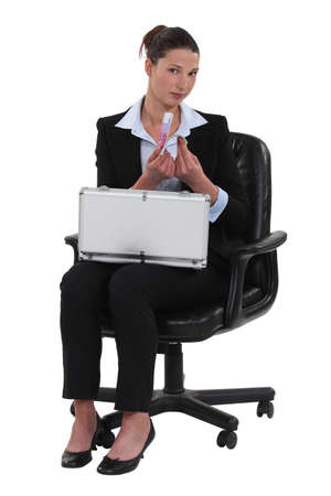 Woman with a briefcase full of money photo