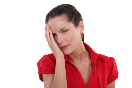 ocular: young woman having ocular pain Stock Photo