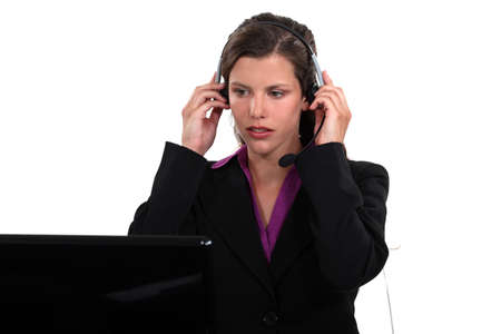 Receptionist putting her headset on photo