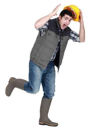 fleeing: Tradesman fleeing Stock Photo