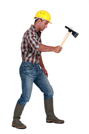 Woodworker with a hatchet Stock Photo