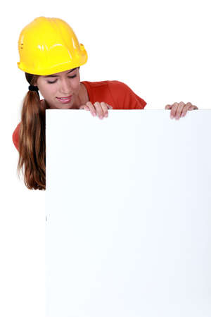 Female laborer with a blank board Stock Photo - 17732300