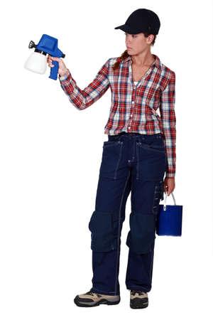A female painter with a spray gun Stock Photo - 17716039