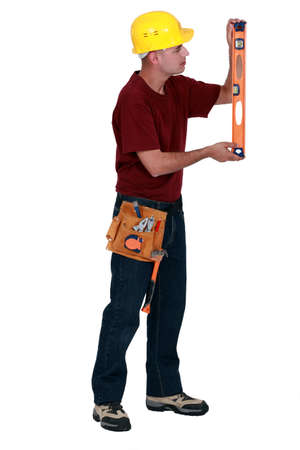 Worker checking a spirit level photo