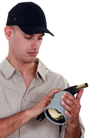blowtorch: Man holding a blowtorch Stock Photo