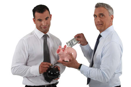 Businessmen with piggy banks photo