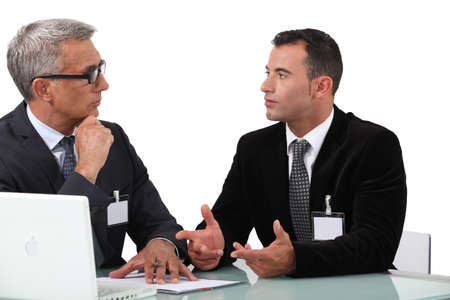 businessmen having a discussion photo
