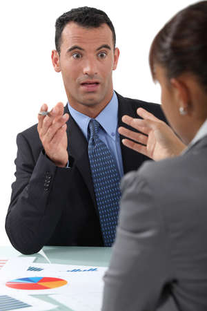 businessman and businesswoman having a discussion photo