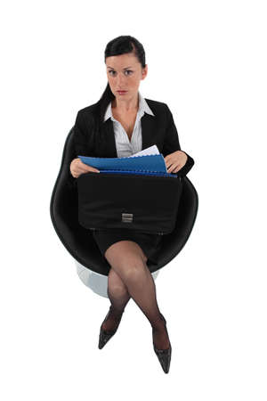 Businesswoman reviewing her files before a meeting photo